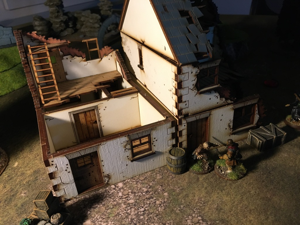 The already half burned house collapse, luckily Riddle manage to dodge the rubbles